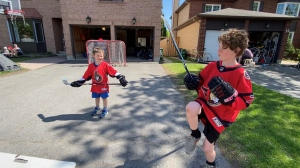 Cooper and Emmett Leppard are Sens super-fans, looking forward to a playoff run next season. Ottawa, On. May 13, 2020. (Tyler Fleming / CTV News)