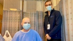 Ross Mangan, 31, and Dr. Robert James (RJ) Cusimano are seen in this photograph taken by Unity Health Network.