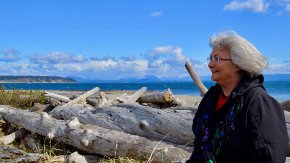 Vivian Hermansen stands on a beach