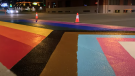 The crosswalk celebrating Pride in 2021 is slightly different than in the past with an added chevron highlighting queer people of colour and transgender individuals (Supplied/City of Edmonton/YouTube).