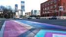 The crosswalk celebrating Pride in 2021 is slightly different than in the past with an added chevron highlighting queer people of colour and transgender individuals (CTV News Edmonton/Sean Amato).