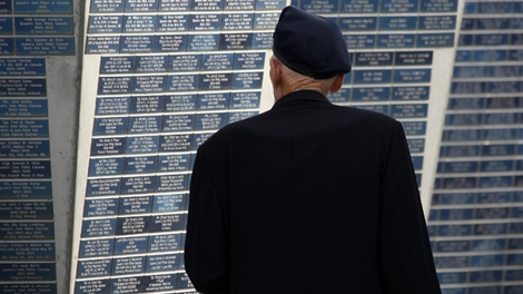 Canadian veteran Leo Goulet stands before a memorial during ceremonies to honour Metis veterans of WWII, at Juno Beach Centre, near Caen, Normandy, France, Wednesday, Nov. 11, 2009. (AP / David Vincent)