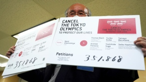Kenji Utsunomiya after submitting a petition to the Tokyo government calling for the cancellation of the Tokyo 2020 Olympics and Paralympics.  (Eugene Hoshiko / AP)
