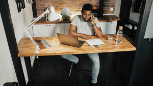 This stock image shows a man working remotely. (Pexels)
