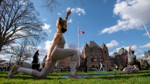 Members of the fitness community gather for a workout on the lawn of Queen's Park in Toronto. THE CANADIAN PRESS/Frank Gunn
