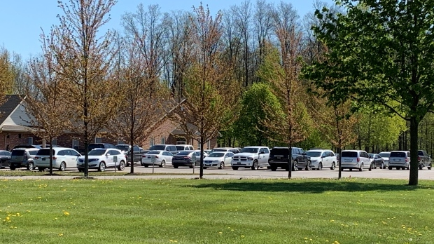 Vehicles are seen in the parking lot of the Church of God in Aylmer, Ont. on Friday, May 14, 2021. (Bryan Bicknell / CTV News)