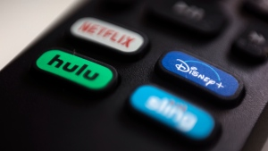In this Aug. 13, 2020 file photo, the logos for Netflix, Hulu, Disney Plus and Sling TV are pictured on a remote control in Portland, Ore. (AP Photo/Jenny Kane)