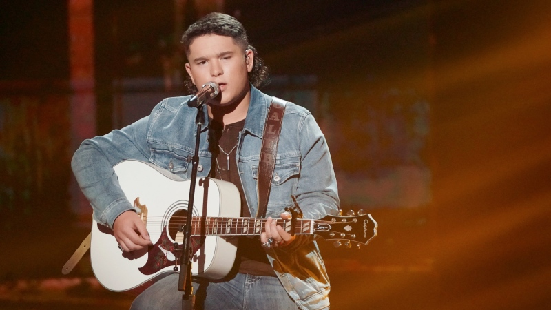 "Caleb Kennedy is out of the Top 5 on ""American Idol"" and has apologized for a video that shows him with someone wearing a Ku Klux Klan-style hood. (Eric McCandless/ABC via CNN)"