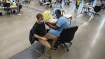 People get vaccinated at the Palais de Congress COVID-19 vaccination clinic, Thursday, May 13, 2021 in Montreal.THE CANADIAN PRESS/Ryan Remiorz