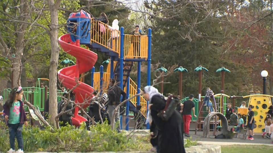 People gather at local park