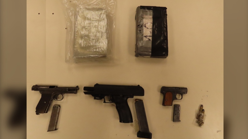 Police say they as a result of the searches, they seized a quantity of cocaine, cash, three loaded handguns and ammunition. (Photo courtesy: Halifax police)