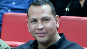 Alex Rodriguez sits court side during the first half of an NBA basketball game between the Miami Heat and Los Angeles Lakers in Miami, in this Friday, Dec. 13, 2019, file photo. Minnesota Timberwolves owner Glen Taylor has reached agreement on his $1.5 billion sale of the club. He's selling to e-commerce mogul Marc Lore and former baseball star Alex Rodriguez. The news was confirmed by a person with knowledge of the negotiation speaking on condition of anonymity because league approval was still pending. (AP Photo/Lynne Sladky, File)