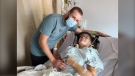 Brianna Seewald in hospital with her fiancé following a serious crash on Aug. 17, 2020, that resulted in her suffering a broken neck and six breaks in her back. (Source: Brianna Seewald)