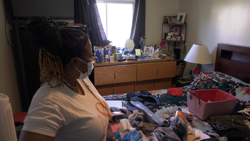 Corrine Davis-Ryan stands in her bedroom after she says someone ransacked the room during a break-in at her Barrie, Ont. home. Fri. May 14, 2021 (Kraig Krause/CTV News)