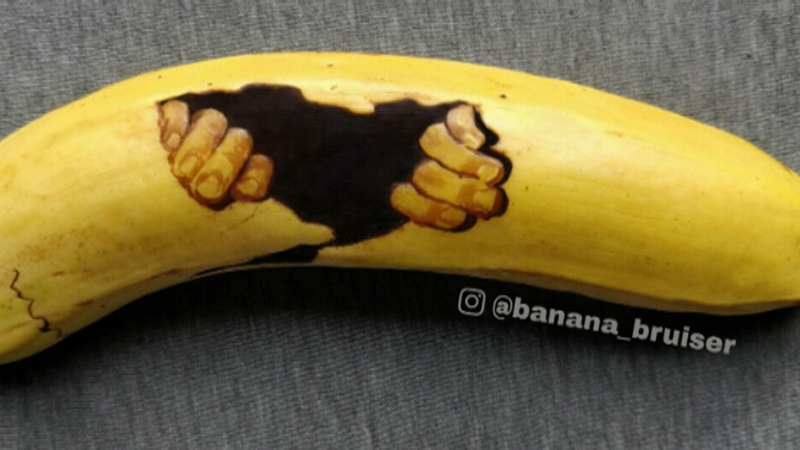 Woman creating art by bruising bananas