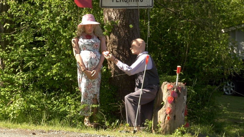 Kevin Deboef first began using an old mannequin to try to slow traffic down in front of his Island Highway home, but soon transitioned it into a display of romance and intrigue. (CTV)