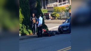 Witness video shows the aftermath of a crash in Burnaby, B.C., on May 13, 2021, during which a man can be heard using an anti-Asian slur.