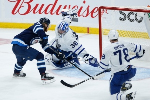 Winnipeg Jets' Kyle Connor (81) scores on Toronto Maple Leafs goaltender Jack Campbell (36) as TJ Brodie (78) defends during second period NHL action in Winnipeg on Friday, May 14, 2021.