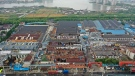 Damage to buildings from a reported tornado is seen in an aerial view in Shengze township in Suzhou in eastern China's Jiangsu Province, Saturday, May 15, 2021. (Chinatopix via AP)