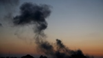 Smoke rises following Israeli airstrikes on a building in Gaza City, Friday, May 14, 2021. (AP Photo/Hatem Moussa)