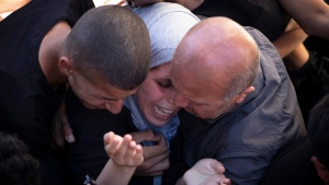 Palestinian mourners react during the funeral of Malek Hamdan, at the village of Salem, near of the West Bank city of Nablus, Saturday, May 15, 2021. Hamdan was killed in clashes with Israeli forces on Friday. (AP Photo/Majdi Mohammed)