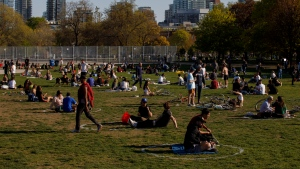 People use social distancing circles at Trinity-Bellwoods park in Toronto, on Thursday, May 13, 2021. THE CANADIAN PRESS/Cole Burston