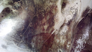 Hand prints in Pettakere Cave at Leang-Leang Prehistoric Site, Maros-Pangkep, Indonesia. (Wikipedia Commons)