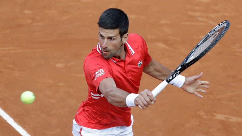Serbia's Novak Djokovic returns the ball to Italy's Lorenzo Sonego during their semi-final match at the Italian Open tennis tournament, in Rome, Saturday, May 15, 2021. (AP Photo/Gregorio Borgia)