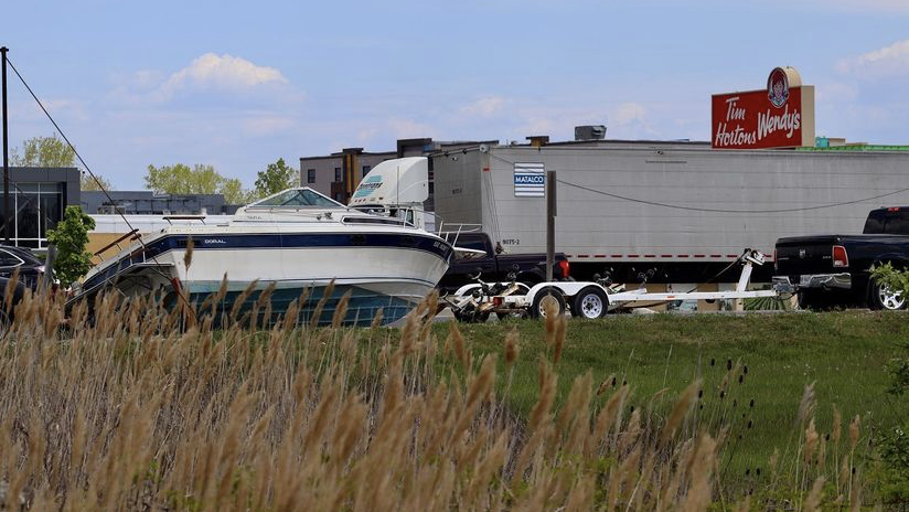 A boat became detached from its trailer on Manning Road in Tecumseh, Ont. on Saturday, May 15, 2021. (courtesy OnLocation/Twitter)