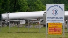 Tanker trucks are parked near the entrance of Colonial Pipeline Company Wednesday, May 12, 2021, in Charlotte, N.C. (AP Photo/Chris Carlson)