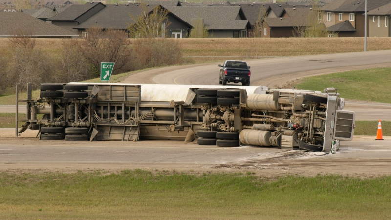 Police say there is a clean up of the spilled load which appears to be agricultural seed. (Tyler Barrow/CTV News)