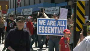 A crowd marches through downtown Ottawa in protest of Ontario's stay-at-home order and other COVID-19 restrictions. May 15, 2021. (Shaun Vardon / CTV News Ottawa)