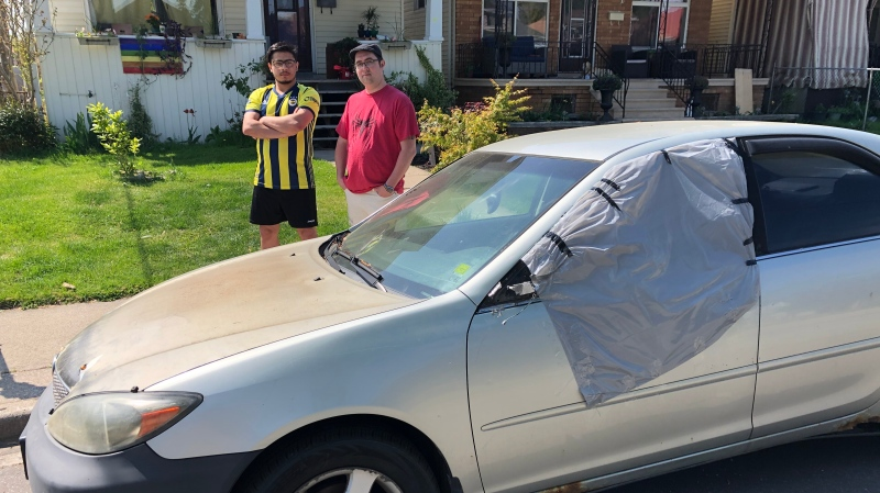Ali Arab (left) and Aaron Bergeron (right) in front of Bergeron's Tuscarora Street home where Arab's vehicle was parked and vandalized in Windsor, Ont. on Saturday, May 15, 2021. (Alana Hadadean/CTV Windsor)