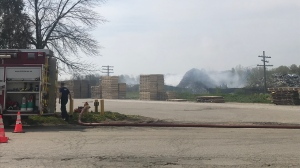 Fire crews on scene at a scrap metal yard in Kitchener. (Johnny Mazza/CTV Kitchener) (May 15, 2021)