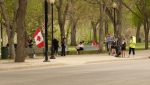 "Saskatoon police respond to a ""freedom rally"" protest at the Vimy Memorial on Spadina Cresent (Tyler Barrow/CTV Saskatoon)"
