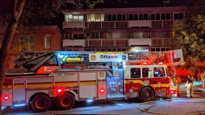 Ottawa firefighters at the scene of a fire at an apartment building on St. Patrick Street. May 15, 2021. (Photo courtesy of Scott Stilborn/OFSFirePhoto/Twitter)