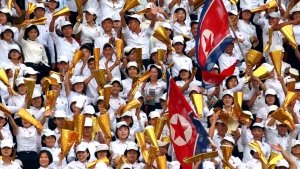 In this Sept. 5, 2019 file photo, North Korea's fans celebrate during the World Cup Group H qualifying soccer match between North Korea and Lebanon at the Kim Il Sung Stadium in Pyongyang, North Korea. (AP Photo/Jon Chol Jin, File)