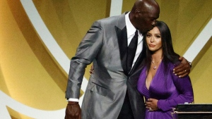 Vanessa Bryant is greeted by NBA icon Michael Jordan after speaking on behalf of Kobe Bryant during the Basketball Hall of Fame Enshrinement Ceremony at Mohegan Sun Arena in Uncasville, Connecticut.