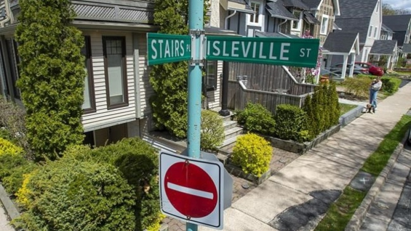 A sign marks Stairs Place in the Hydrostone district in the North end of Halifax on Thursday, May 13, 2021. The street was named for William Grant Stairs, a Canadian explorer from Halifax who helped lead some of the most controversial expeditions through the African continent. THE CANADIAN PRESS/Andrew Vaughan