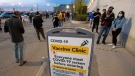 Hundreds of people line up for the Peel Region Doses After Dark vaccination clinic in Mississauga, Ont. on Saturday, May 15, 2021. THE CANADIAN PRESS/Frank Gunn
