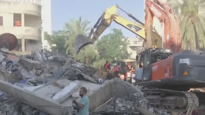 Rescue team sifts through rubble