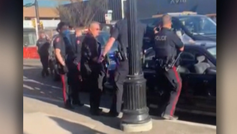 Calgary police officers arrested Kevin J. Johnston following an outdoor gathering on 17th Avenue on Saturday morning. (Supplied/Haley Christianson)