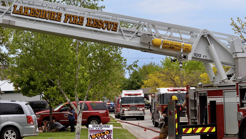 Lakeshore fire crews responded to a house fire in the 100 block of Duck Creek Boulevard in Belle River, Ont. on Sunday, May 16, 2021. (courtesy OnLocation/Twitter)