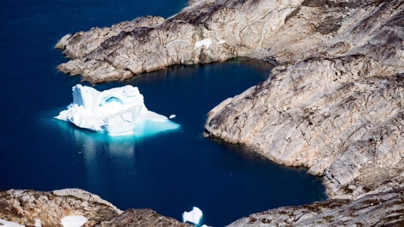 This aerial file photo taken on Aug. 15, 2019 shows an iceberg floating off the eastern coast of Greenland, part of a vast and increasingly coveted Arctic region. (AFP)