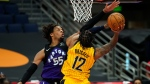 Toronto Raptors forward Freddie Gillespie (55) fouls Indiana Pacers forward Oshae Brissett (12) during the first half of an NBA basketball game Sunday, May 16, 2021, in Tampa, Fla. (AP Photo/Chris O'Meara)