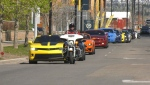 A parade of expensive sports cars drove past the Ronald McDonald House and the Alberta Children's Hospital on Sunday.