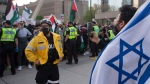 A pro-Israel supporter chants at pro-Palestine supporters during a demonstration against the current violence in Gaza in Toronto on Saturday, May 15, 2021. THE CANADIAN PRESS/Chris Young