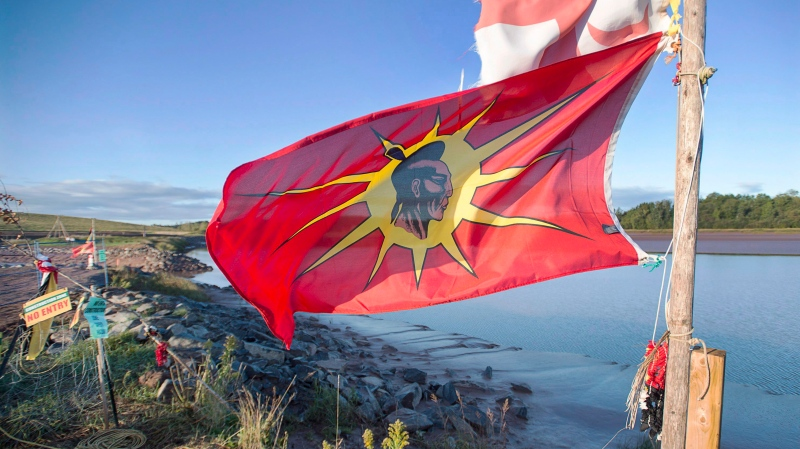 In this file photo, a warrior flag flies near the Shubenacadie River in Fort Ellis, N.S. on Monday, Sept. 26, 2016. (THE CANADIAN PRESS/Andrew Vaughan)