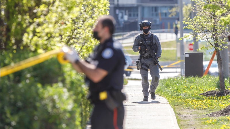Police work the scene of a shooting in Etobicoke area of Toronto on Sunday, May 16, 2021. One man is dead and three others were wounded in a shooting in Toronto's west end on Sunday afternoon. THE CANADIAN PRESS/Cole Burston