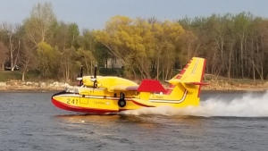 A water bomber is pictured on the Red River north of Selkirk on Sunday, May 16, 2021. (Source: Karen Fey)